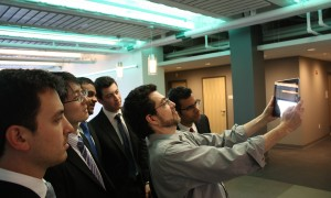AR Software Developer Paul Girardo demonstrates one of the building's AR markers.