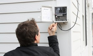 Fraunhofer CSE's Dr. Peter Engelmann checks a data logger at a high-performance home.