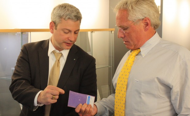 Joseph Kennedy and CSE Managing Director Nolan Browne look at a Fraunhofer-developed phase change material.