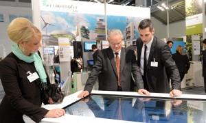 Dr. Hans-Jörg Bullinger, former President of the Fraunhofer Society, looks over project details for the Building Technology Showcase.