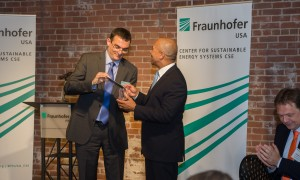 Fraunhofer CSE Director Christian Hoepfner presents MA Governor Deval Patrick with a commemorative solar cell at the Grand Opening of the Fraunhofer CSE Living Laboratory. ©Fraunhofer CSE