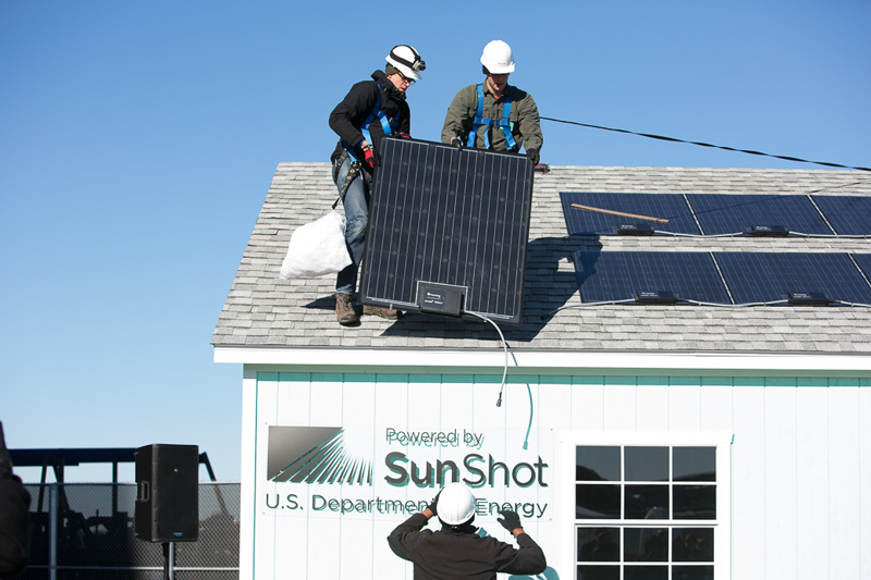The Fraunhofer CSE Plug & Play PV System being installed on a test rooftop during a 2014 public demonstration.